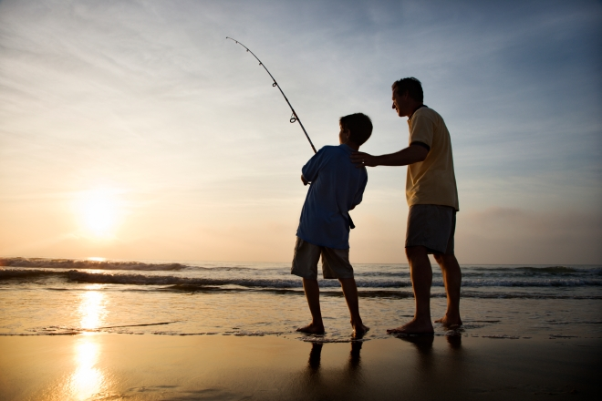Father and son fishing on the coast.